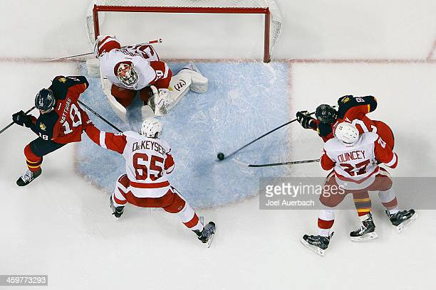 Tomas Kopecky of the Florida Panthers shoots the puck against goaltender Jonas Gustavsson of the Detroit Red Wings late in the third period at the...