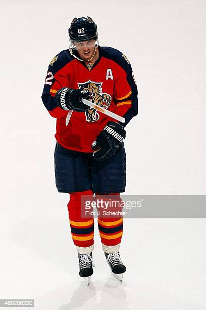 Tomas Kopecky of the Florida Panthers skates with a victory giveaway stick after their win against the Buffalo Sabres at the BBT Center on December 6...