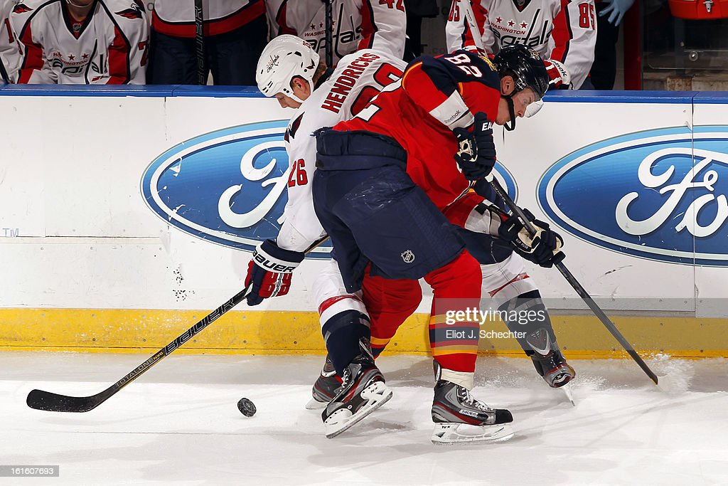 Tomas Kopecky #82 of the Florida Panthers tangles with Matt Hendricks #26 of the Washington Capitals at the BB&T Center on February 12, 2013 in Sunrise, Florida.