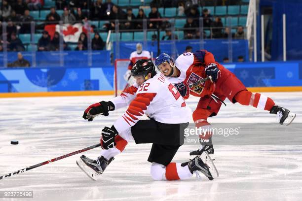 Tomas Kundratek of the Czech Republic fires the puck against Christian Thomas of Canada in the third period during the Men's Bronze Medal Game on day...