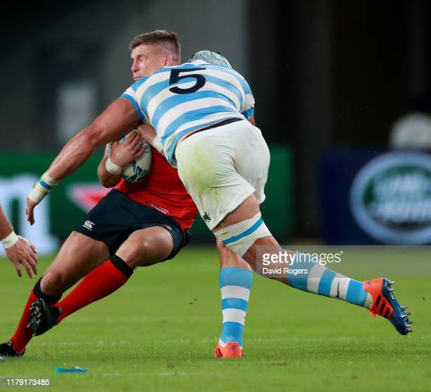 Tomas Lavanini of Argentina high tackles Owen Farrell and is shown the red card by referee Nigel Owens during the Rugby World Cup 2019 Group C game...