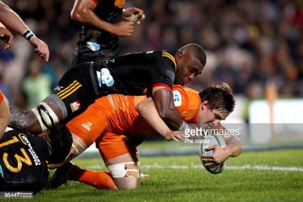 Tomas Lezana of the Jaguares is tackled during the round 12 Super Rugby match between the Chiefs and the Jaguares at Rotorua International Stadium on...