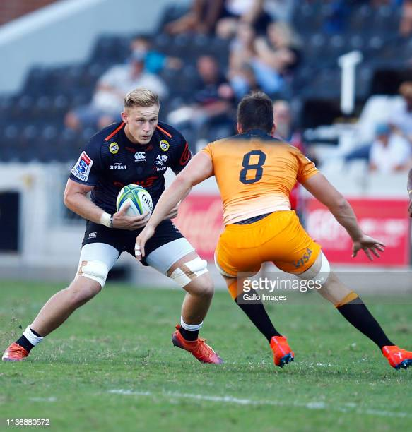 Tomas Lezana of the Jaguares looks to tackle Daniel Du Preez of the Cell C Sharks during the Super Rugby match between Cell C Sharks and Jaguares at...