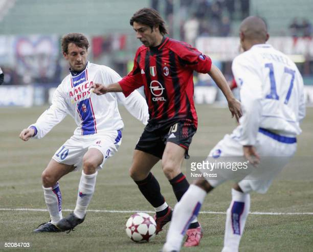 Tomas Locatelli of Milan evades Rui Costa of Bolgna during the Serie A match between AC Milan and Bologna at the Guiseppe Meazza San Ciro stadium on...