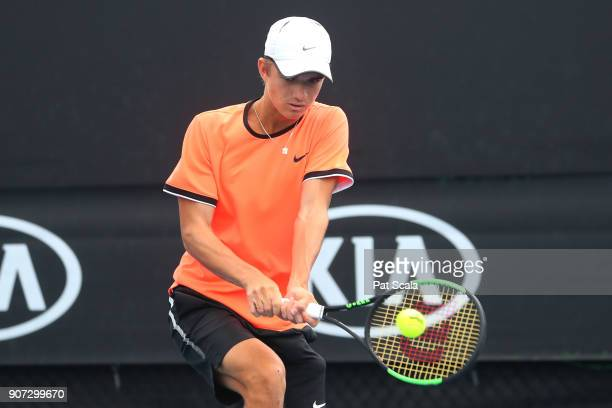 Tomas Machac of the Czech Republic plays a backhand against Rudolf Molleker of Germany during the Australian Open 2018 Junior Championships at...