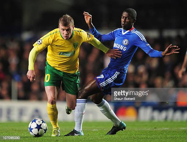 Tomas Majtan of MSK Zilina is challenged by Ramires of Chelsea during the UEFA Champions League Group F match between Chelsea and MSK Zilina at...