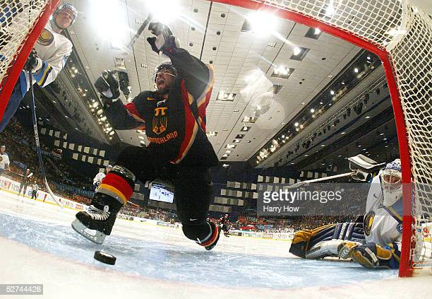 Tomas Martinec of Germany celebrates his goal as goaltender Vitaliy Kolesnik of Kazakhstan watches the puck slide into the crease in the IIHF World...