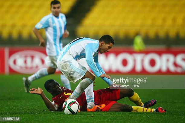 Tomas Martinez of Argentina is challenged by Godfred Donsah of Ghana during the FIFA U20 World Cup New Zealand 2015 Group B match between Argentina...