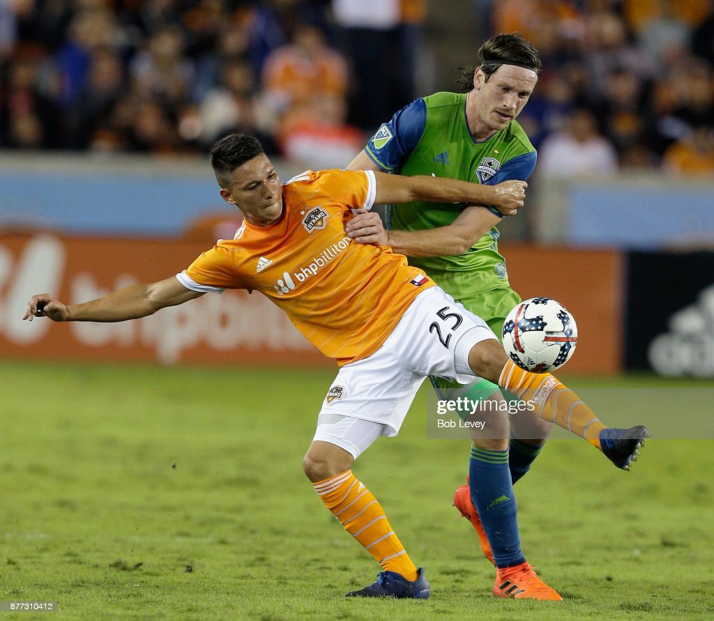 Tomas Martinez #25 of Houston Dynamo attempts to control the ball as Gustav Svensson #4 of Seattle Sounders defends at BBVA Compass Stadium on November 21, 2017 in Houston, Texas.
