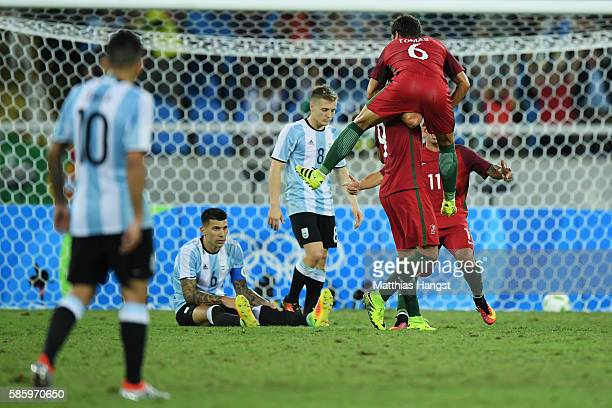 Tomas Martins Podstawski and Paciencia Goncalo of Portugal celebrate after scoring during the Men's Group D first round match between Portugal and...