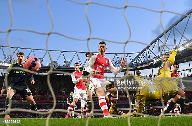 Tomas Mejias of Middlesbrough makes a save from Alexis Sanchez of Arsenal during the FA Cup fifth round match between Arsenal and Middlesbrough at...