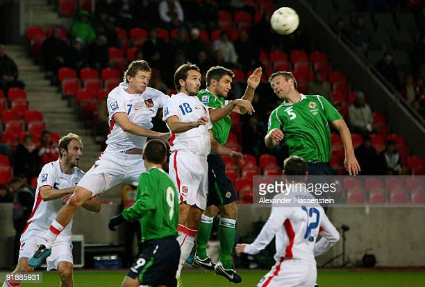Tomas Necid of Czech Republic and his team mate Tomas Sivak battle for the ball with Garet McAuley of Northern Ireland as well as team mate Stephen...