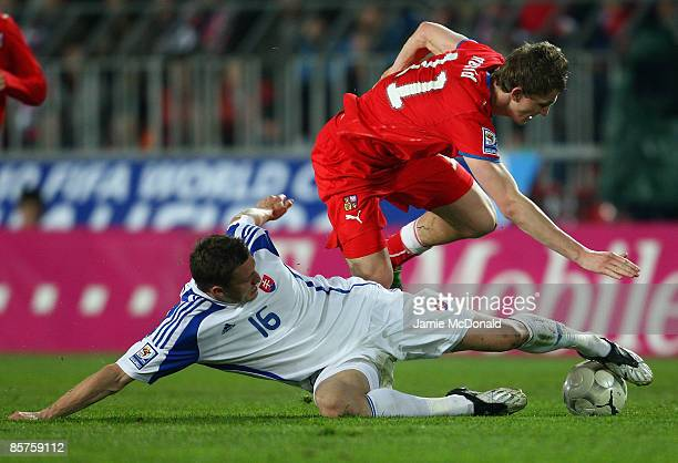 Tomas Necid of Czech Republic battles with Jan Durica of Slovakia during the FIFA 2010 World Cup qualifier between Czech Republic and Slovakia at the...