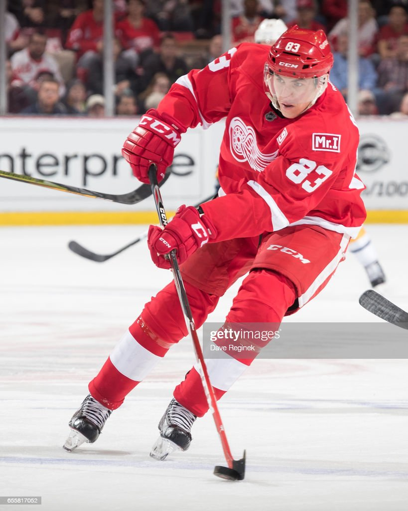 Tomas Nosek #83 of the Detroit Red Wings skates up ice with the puck during an NHL game against the Buffalo Sabres at Joe Louis Arena on March 20, 2017 in Detroit, Michigan.