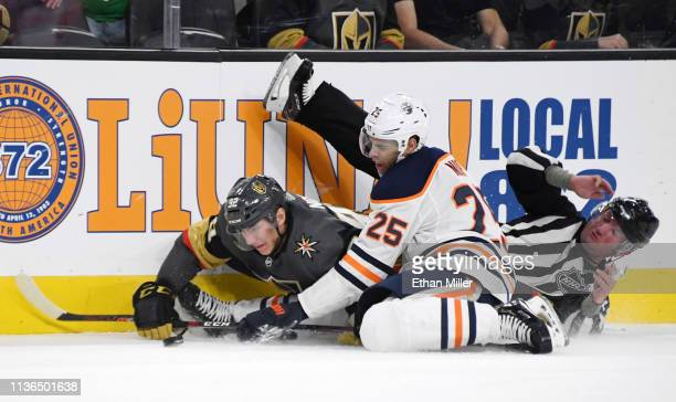 Tomas Nosek of the Vegas Golden Knights and Darnell Nurse of the Edmonton Oilers crash into linesman Derek Nansen as they go after the puck in the...