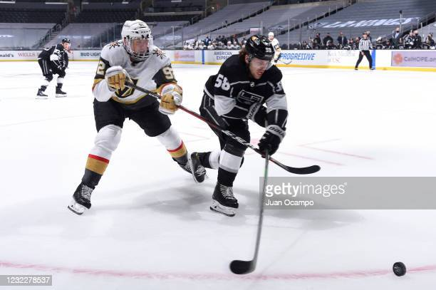 Tomas Nosek of the Vegas Golden Knights and Kurtis MacDermid of the Los Angeles Kings battle for position during the third period against the Los...