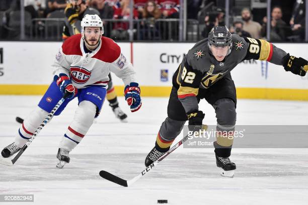 Tomas Nosek of the Vegas Golden Knights and Victor Mete of the Montreal Canadiens skate to the puck during the game at TMobile Arena on February 17...