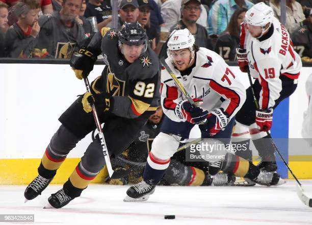 Tomas Nosek of the Vegas Golden Knights is pursued by TJ Oshie of the Washington Capitals during the second period in Game One of the 2018 NHL...