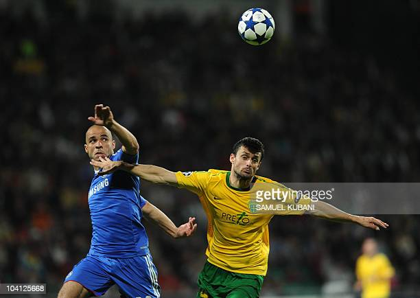 Tomas Oravec of MSK Zilina vies for the ball with Alex of Chelsea during the UEFA Champions League group F match between MSK Zilina on September 15,...