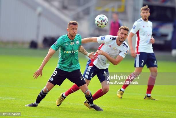 Tomas Pekhart of Legia Warszawa competes with Pawel Bochniewicz of Gornik Zabrze during the PKO Ekstraklasa match between Gornik Zabrze and Legia...
