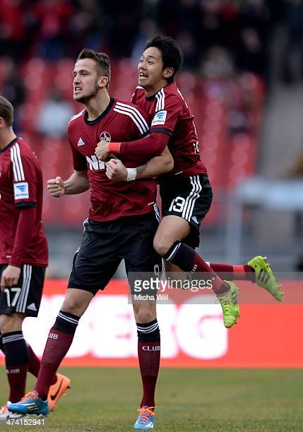Tomas Pekhart of Nuernberg celebrates after scoring his team's second goal and is hugged by Hiroshi Kiyotake of Nuernberg during the Bundesliga match...