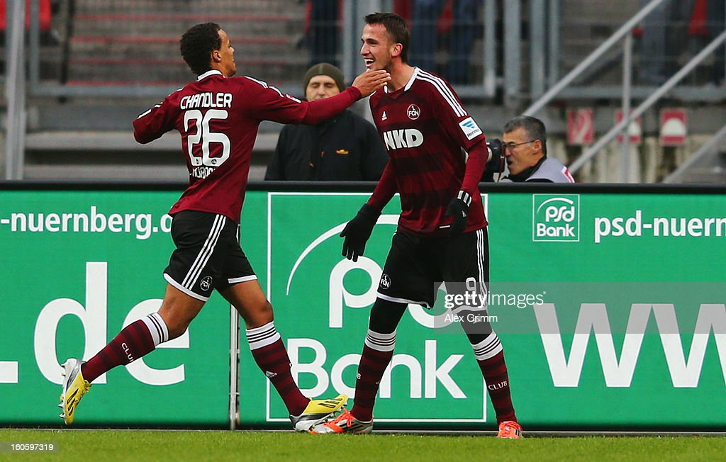 Tomas Pekhart (R) of Nuernberg celebrates his team's second goal with team mate Timothy Chandler during the Bundesliga match between 1. FC Nuernberg and VfL Borussia Moenchengladbach at Easy Credit Stadium on February 3, 2013 in Nuremberg, Germany.
