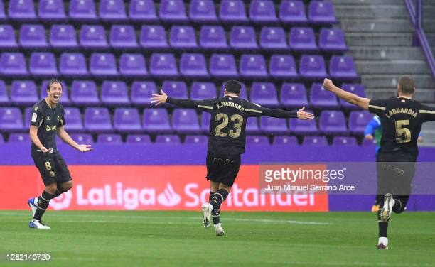 Tomas Pina of Deportivo Alaves celebrates with team mates Ximo Navarro and Victor Laguardia after scoring his sides first goal during the La Liga...