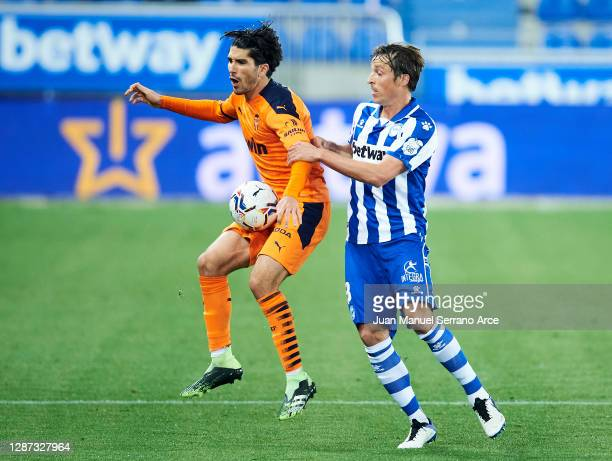 Tomas Pina of Deportivo Alaves duels for the ball with Carlos Soler of Valencia CF during the LaLiga Santander match between Alaves and Valencia on...