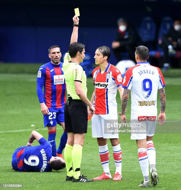Tomas Pina of Deportivo Alaves is shown a yellow card by match referee Jose Luis Munuera Montero during the La Liga Santander match between SD Eibar...