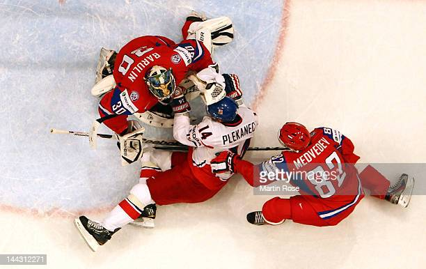 Tomas Plekanec of Czech Republic crashes into Konstantin Barulin , goaltender of Russia during the IIHF World Championship group S match between...