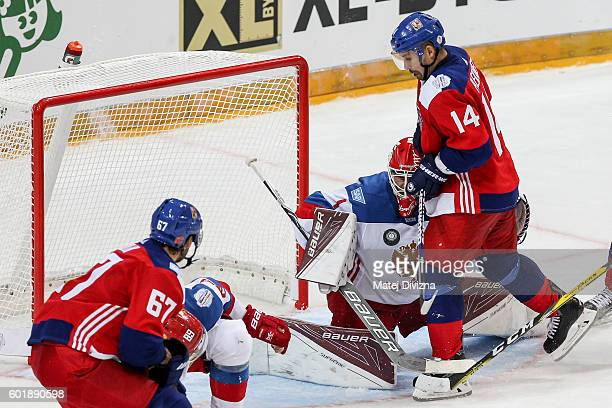 Tomas Plekanec of Czech Republic scores over goalkeeper of Russia Semyon Varlamov during the 2016 World Cup of Hockey preparation match between Czech...