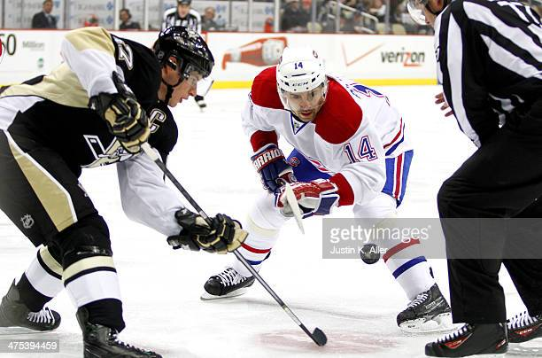 Tomas Plekanec of the Montreal Canadiens and Sidney Crosby of the Pittsburgh Penguins take a faceoff during the game at Consol Energy Center on...