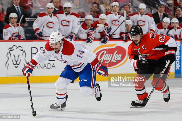 Tomas Plekanec of the Montreal Canadiens breaks away from Erik Karlsson of the Ottawa Senators and scores during the NHL game at Canadian Tire Centre...