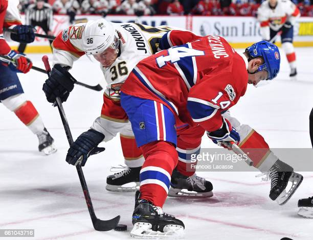 Tomas Plekanec of the Montreal Canadiens faces off against Jussi Jokinen of the Florida Panthers in the NHL game at the Bell Centre on March 30 2017...