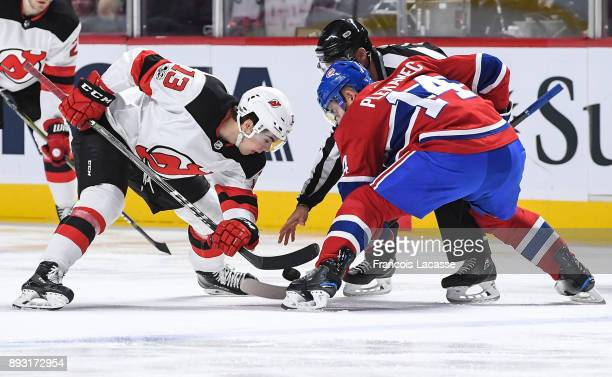 Tomas Plekanec of the Montreal Canadiens faces off against Nico Hischier of the New Jersey Devils in the NHL game at the Bell Centre on December 14...