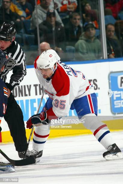 Tomas Plekanec of the Montreal Canadiens faces off during the game against the New York Islanders on December 7, 2006 at the Nassau Coliseum in...
