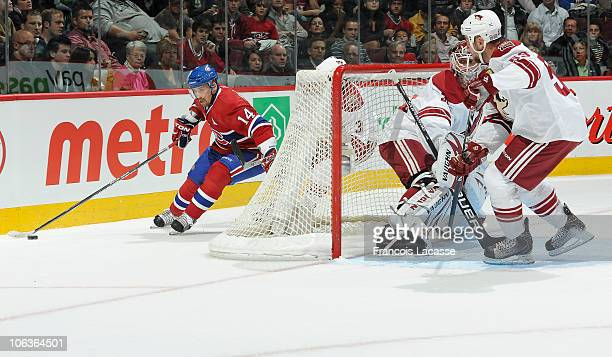 Tomas Plekanec of the Montreal Canadiens gets around the net of the Phoenix Coyotes during the NHL game on October 25 2010 at the Bell Centre in...