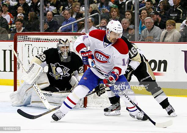 Tomas Plekanec of the Montreal Canadiens handles the puck against Brandon Sutter of the Pittsburgh Penguins during the game at Consol Energy Center...