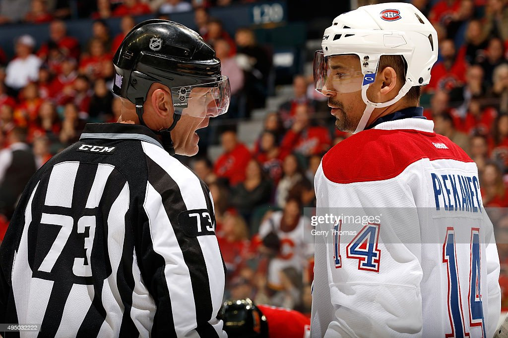 Tomas Plekanec #14 of the Montreal Canadiens has a discussion with a referee during an NHL game against the Calgary Flames at Scotiabank Saddledome on October 30, 2015 in Calgary, Alberta, Canada.