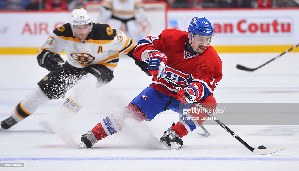 Tomas Plekanec #14 of the Montreal Canadiens is chased by Patrice Bergeron #37 of the Boston Bruins during the NHL game on February 6, 2013 at the Bell Centre in Montreal, Quebec, Canada.