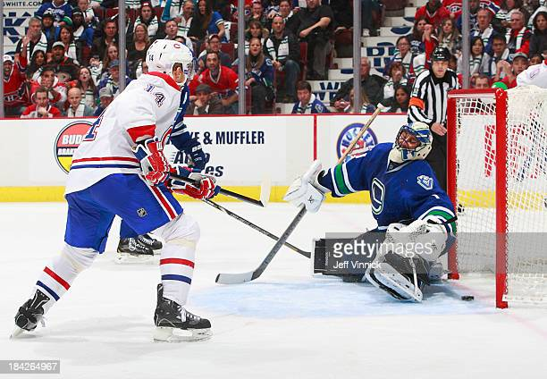 Tomas Plekanec of the Montreal Canadiens scores on Roberto Luongo of the Vancouver Canucks during their NHL game at Rogers Arena on October 12, 2013...
