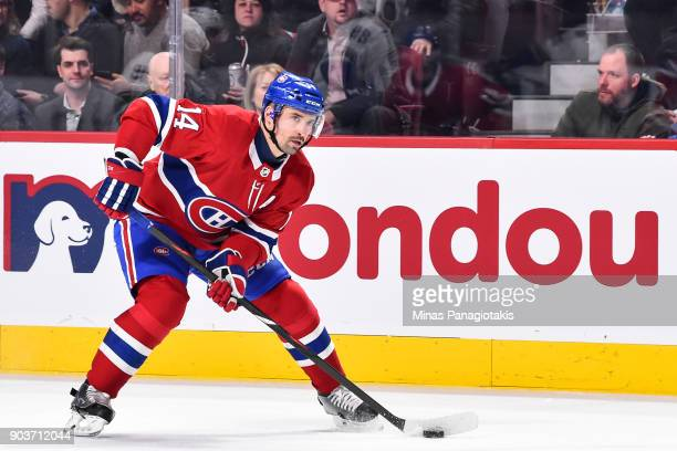 Tomas Plekanec of the Montreal Canadiens skates the puck against the Vancouver Canucks during the NHL game at the Bell Centre on January 7 2018 in...
