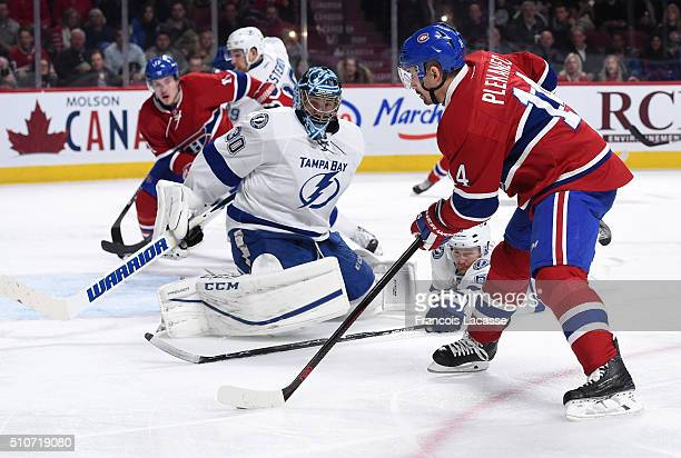 Tomas Plekanec of the Montreal Canadiens takes a shot on goal Ben Bishop of the Tampa Bay Lightning in the NHL game at the Bell Centre on February 9...