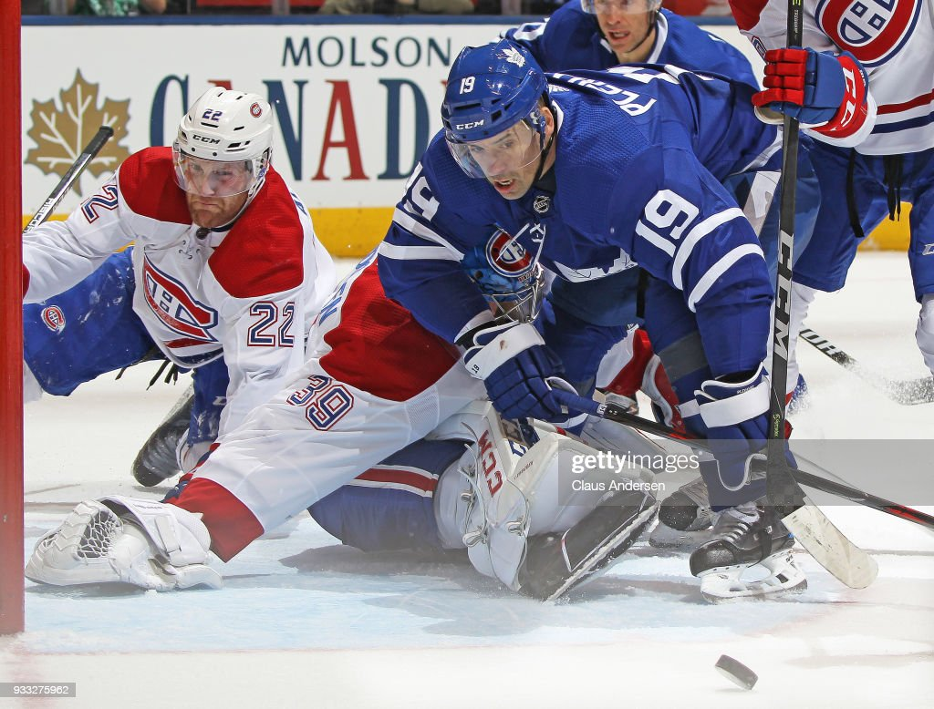 Tomas Plekanec #19 of the Toronto Maple Leafs tries to get a puck past Charlie Lindgren #39 of the Montreal Canadiens during an NHL game at the Air Canada Centre on March 17, 2018 in Toronto, Ontario, Canada. The Maple Leafs defeated the Canadiens 4-0.