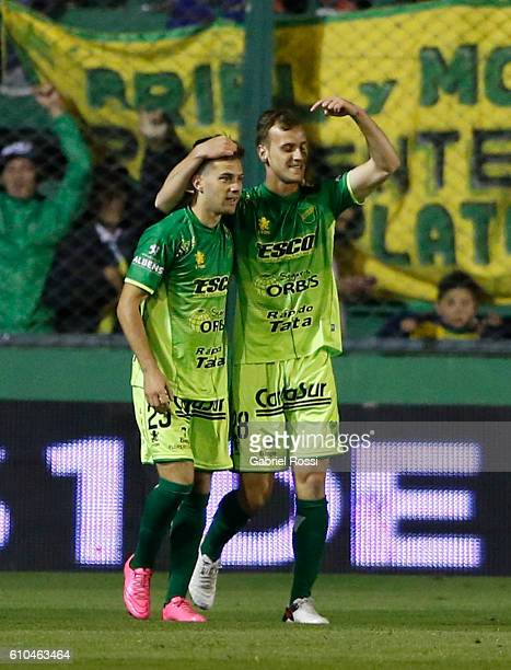 Tomas Pochettino of Defensa y Justicia celebrates with teammates after scoring the first goal of his team during a match between Defensa y Justicia...