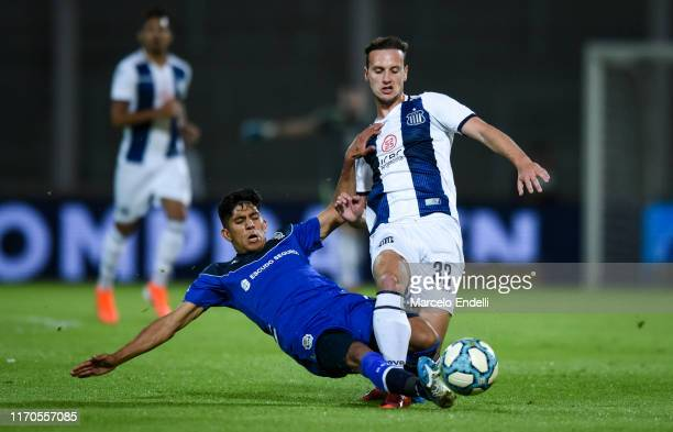 Tomas Pochettino of Talleres fights for the ball with Maximiliano Comba of Gimnasia y Esgrima La Plata during a match between Talleres and Gimnasia y...