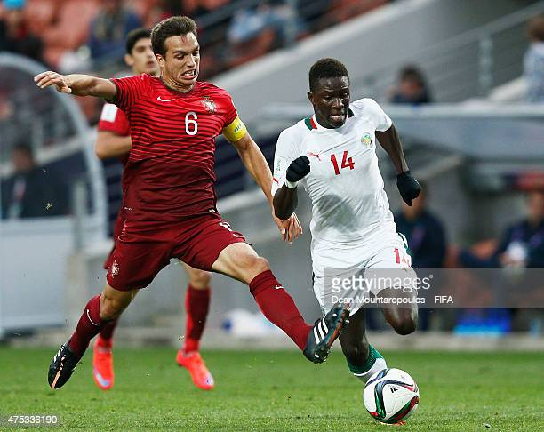 Tomas Podstawski of Portugal and Moussa Kone of Senegal battle for the ball during the FIFA U20 World Cup New Zealand 2015 Group C match between...