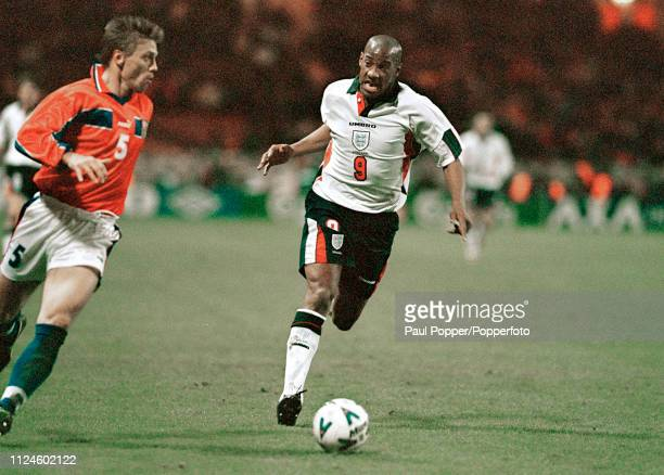 Tomas Repka of the Czech Republic is chased down by Dion Dublin of England during an International Friendly match at Wembley Stadium on November 18...