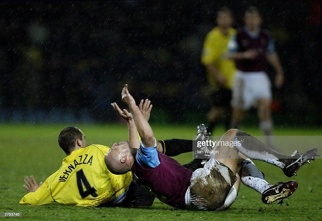 Tomas Repka of West Ham is tackled by Paolo Vernazza of Watford during the Nationwide Division One match between Watford and West Ham United at Vicarage Road on November 22 in Watford, England.