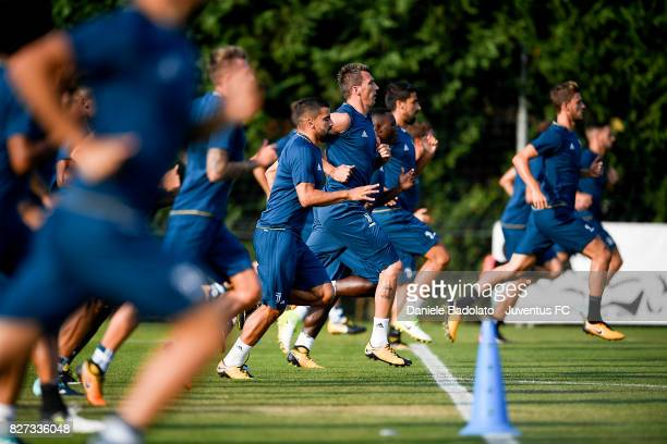 Tomas Rincon and Mario Mandzukic of Juventus during a training session on August 7 2017 in Vinovo Italy